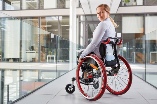 Smiling young woman in a wheelchair for inclusion