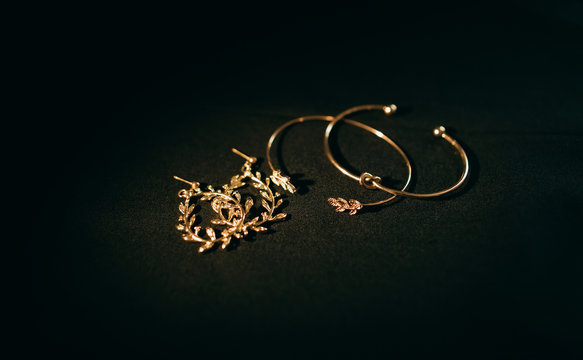 Golden bride jewelry on dark background. Wedding accessories