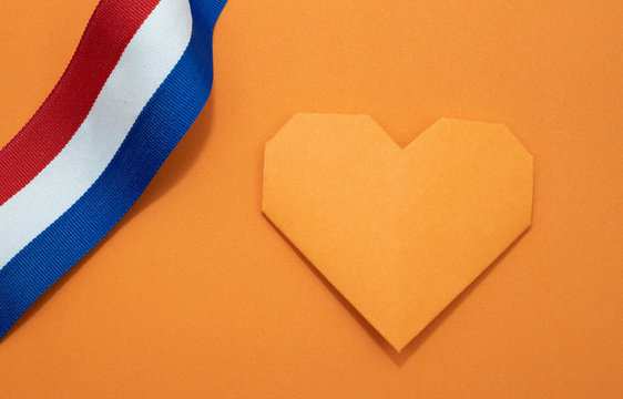 Orange paper heart and red white and blue ribbonn for the Dutch fest called Koningsdag or sport events