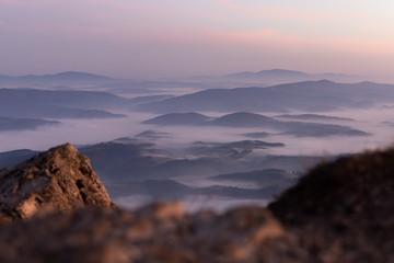 Fotobehang Lavendel Purple sunrise over misty valley