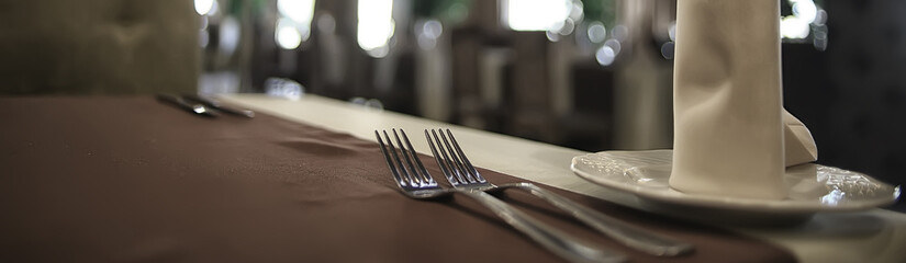 fork and knife serving in the interior of the restaurant / table in a cafe, food industry catering,...