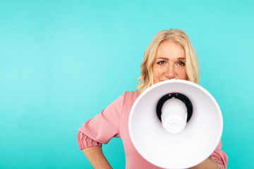 Closeup view of woman with loudspeaker isolated