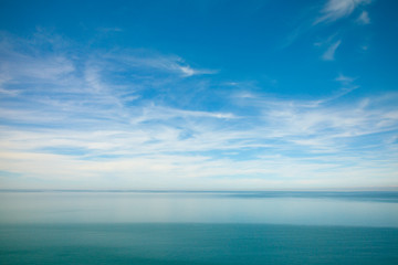 blue ocean waves and sky clouds summer background