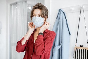Woman wearing medical mask while going outside, protecting from the virus during an epidemic....