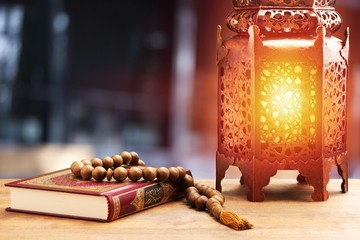 Islamic Holy Book Quran with rosary beads and ornamental arabic lantern