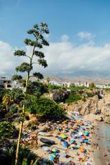 NERJA, SPAIN - AGOSTO 13: Playa Calahonda in Nerja in a beautiful bright sunny day in Nerja, Malaga, Spain