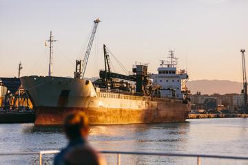 Old cargo boat in Malaga harbor, Spain