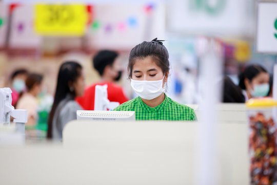 Cashier or supermarket staff and customers in medical protective mask