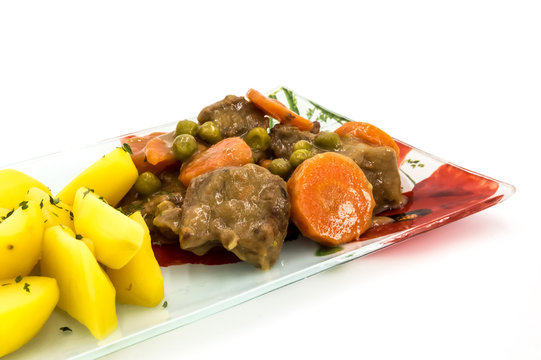 Belgian beef stew in beer with carrots and peas