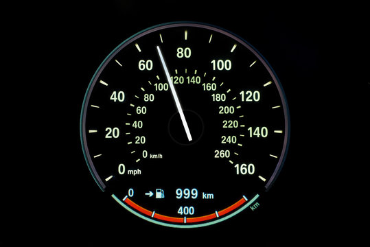 110 Kilometers per hour,light with car mileage with black background,number of speed,Odometer of car.