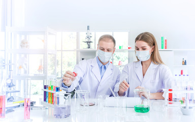 Scientists researching for some confidential in chemical laboratory