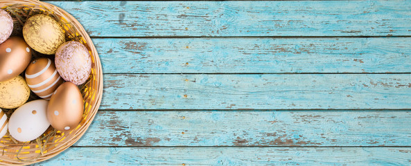 Easter banner, colorful easter eggs on Wooden texture with old cracked blue paint