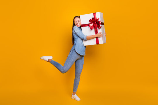 Full body photo energetic content girl celebrate 8-march 14-february day hug big white gift box red ribbon she get friends family wear good look shirt isolated bright shine color background
