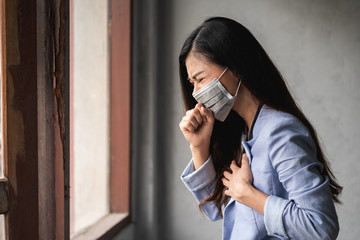 COVID-19 Pandemic Coronavirus, Asian woman wearing mask, have a symptoms coughing and fever