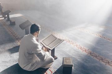 Quran - holy book of Islam mosque Muslim in mosque enuntiat Quran in Ramadan