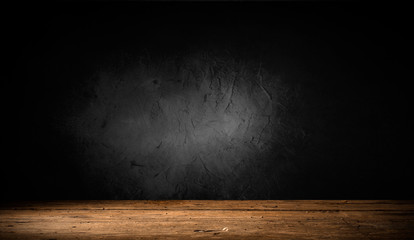 Selected focus empty brown wooden table and wall texture or old black brick wall blur background...
