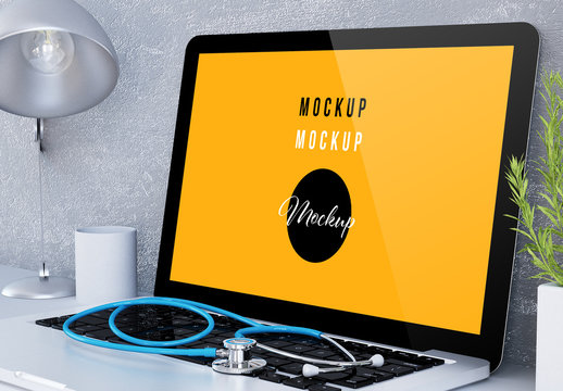 Laptop with Stethoscope on a Desk Mockup