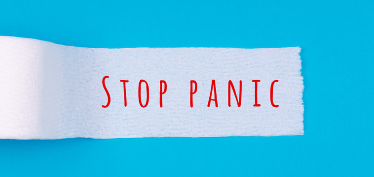 Toilet paper roll with Stop panic wording on the bright blue background. Coronavirus COVID-19 pandemic panic shopping, social distancing concept. Bright monochrome drop in wide screen banner format