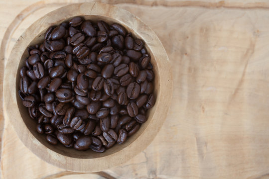 Sumatra Mandeling coffee beans against a wooden background