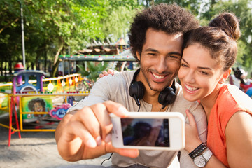Young couple taking picture of themselves.
