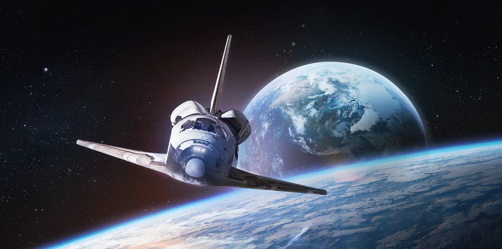 Space shuttle on orbit of the Earth. Light and blue planet. View from space station. Elements of this image furnished by NASA