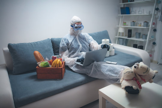 Quarantine and isolation during the virus outbreak - groceries and food in stock, working from home over the internet.