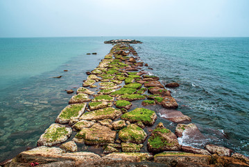 Stone jetty at sea. Stone jetty at sea.