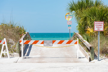 Beaches closed with barriers