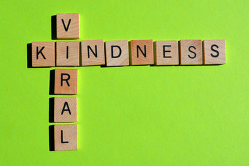 Viral Kindness, words on green background with copy space