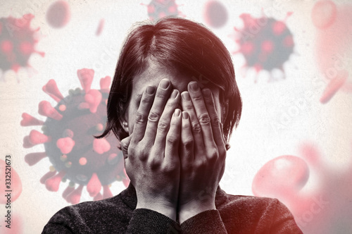 Wall mural Concept of fear of coronavirus. Woman covers her face her hands on background with coronavirus.