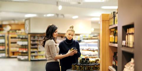 Foto op Plexiglas Bakkerij Two women choosing a dairy products at supermarket.selective focus.