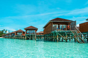 Maldives tropical Island, beautiful isolated luxury water bungalows Maldives in the blue green ocean of the maldives