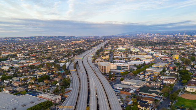Aerial view of empty freeway streets with no people in downtown Los Angeles California USA due to coronavirus pandemic or COVID-19 virus outbreak and quarantine