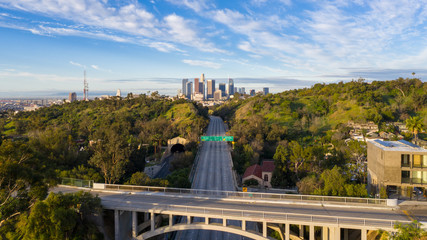 Aerial view of empty freeway streets with no people and no cars in downtown Los Angeles California as result of  coronavirus pandemic or COVID-19 virus outbreak and lockdown.
