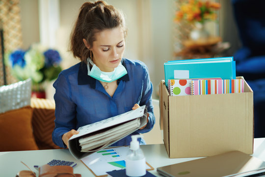 woman with medical mask organising home office