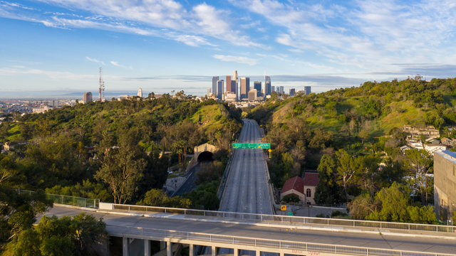 Aerial view of empty freeway streets with no people in downtown Los Angeles California as result of  coronavirus pandemic or COVID-19 virus outbreak and lockdown.