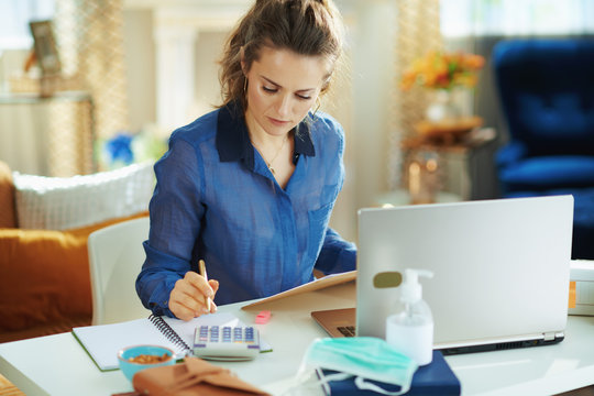 trendy woman at modern home in sunny day working