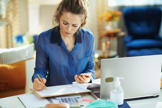trendy woman in modern house in sunny day working