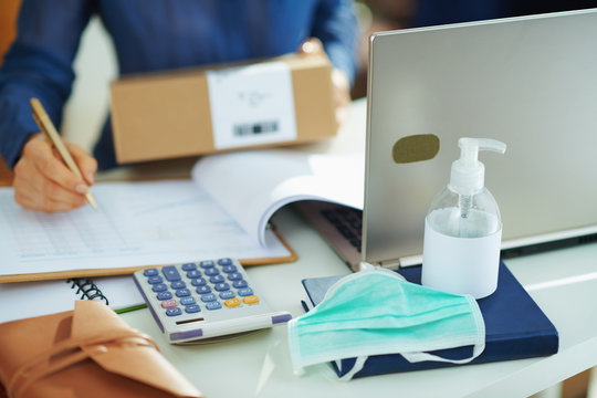 medical mask and hand disinfectant and woman with parcel