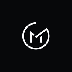Fototapeta Minimal elegant monogram art logo. Outstanding professional trendy awesome artistic GM MG initial based Alphabet icon logo. Premium Business logo White color on black background obraz