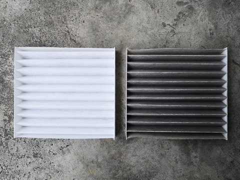 Clean and dirty air filter for air condition in car.Comparison between new and used air filter for car, automotive spare part.