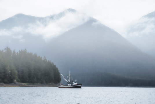 Commercial fishing boat in Southeast Alaska in fog