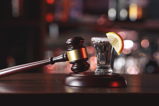 the concept for drink driving.judge hammer, lemon glass and tequila. Do not drink alcohol and do not drive the concept.