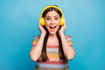 Close-up portrait of her she nice lovely charming cute positive addicted cheerful cheery girl music lover listening radio isolated on bright vivid shine vibrant blue color background