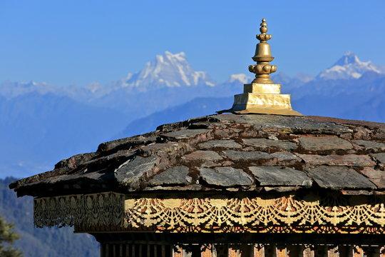 "Dochula pass on the road from Thimpu to Punakha (Bhutan) where 108 memorial chortens or stupas known as ""Druk Wangyal Chortens"" have been built by Ashi Dorji Wangmo Wangchuk, the eldest Queen Mother."