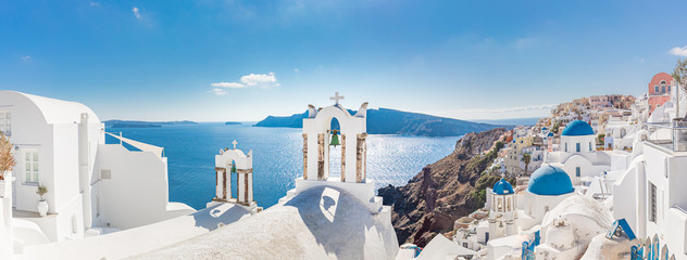 Fotobehang Santorini Amazing panoramic landscape, luxury travel vacation. Oia town on Santorini island, Greece. Traditional and famous houses and churches with blue domes over the Caldera, Aegean sea