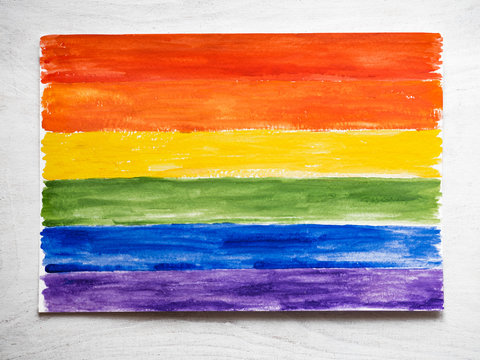 Beautiful postcard with a rainbow flag. Top view, close up