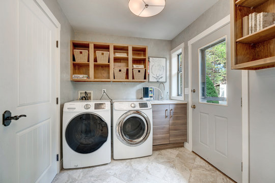 Laundry room with beautiful chelving and natural tones.