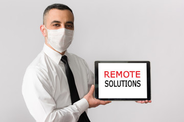 Online Remote Solutions For Coronavirus Concept,  Businessman With Mask Holding Digital Tablet