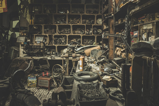 old abandoned mechanical workshop with many messy things